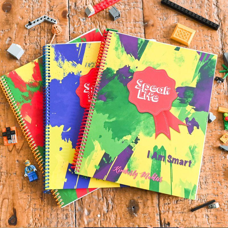 3 Speak Life Badges books on wood with lego