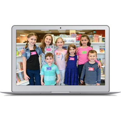 group of children wearing badges on laptop