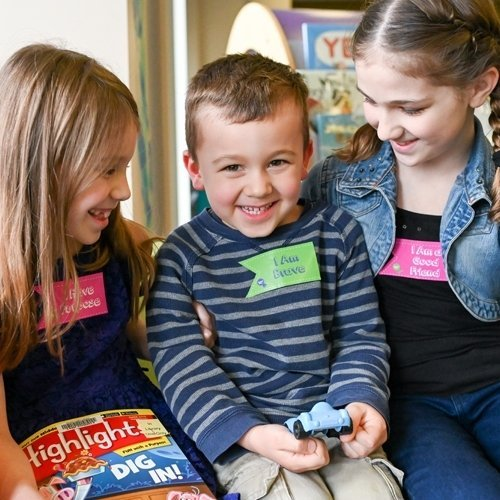 3 children wearing Speak Life Badges stickers
