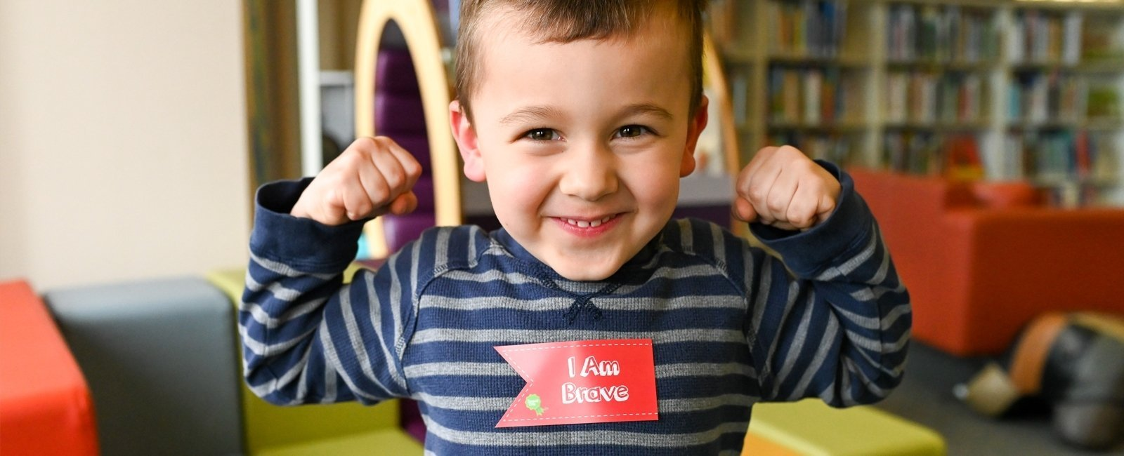 boy wearing i am brave sticker