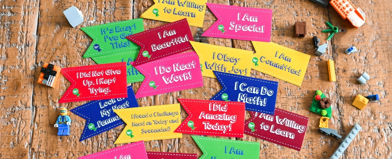 Lots of Speak Life Badges stickers on wood with lego