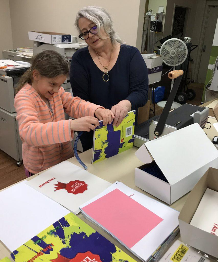 Maria and Kimberly's daughter binding books
