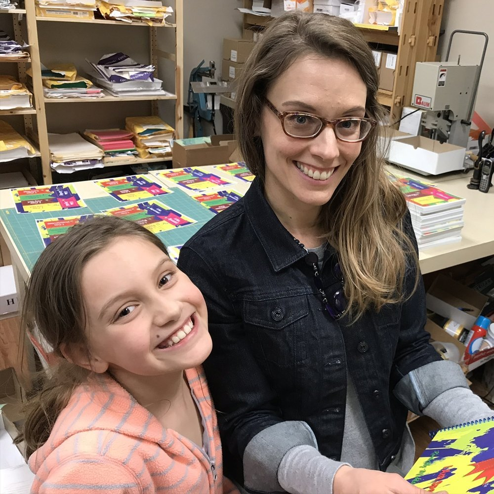 Kimberly and daughter putting together books