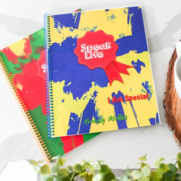 2 Speak Life Badges books on marble with coffee cup