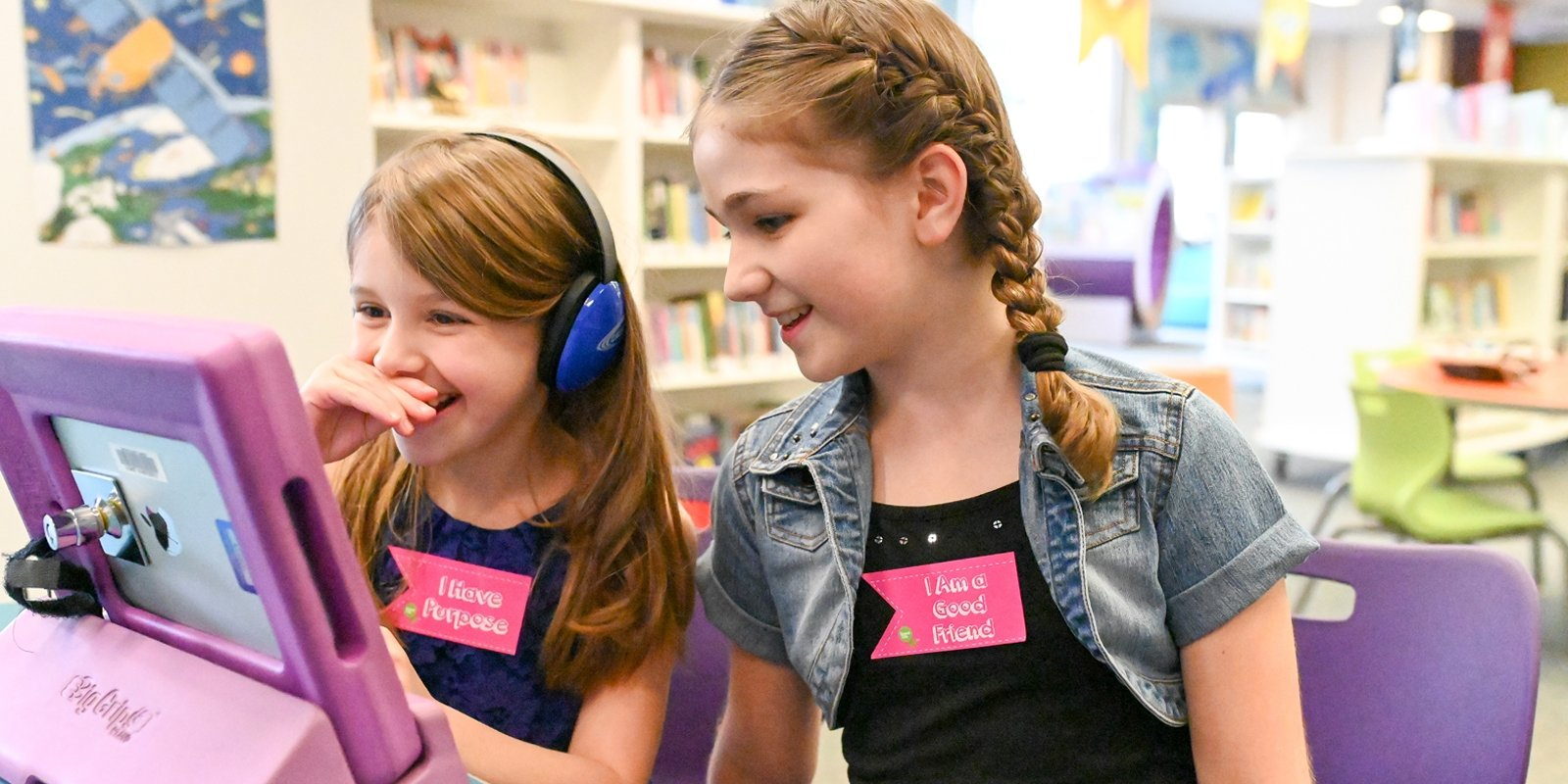 2 girls at computer wearing Speak Life Badges