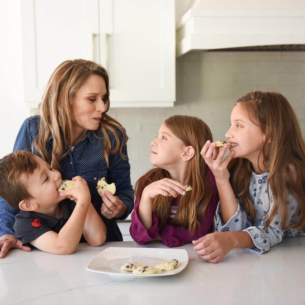Kimberly and kids eating Lemon Cranberry cookies