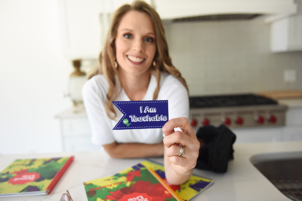 Declare the Opposite - I am Teachable sticker award in Kimberly's hand